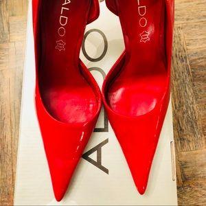 Aldo Red patent leather pumps.